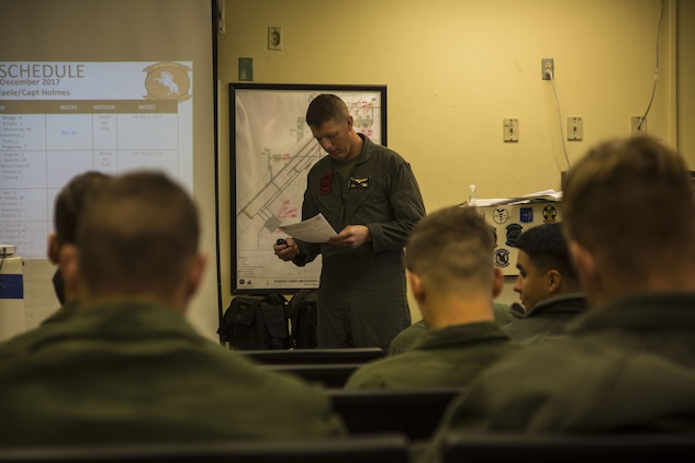 U.S. Marine Corps Capt. Aidan Steele, the acting operation duty officer for Marine Heavy Helicopter Squadron (HMH) 465, gives the flight brief to the pilots and crew who are participating in the Deployment for Training at Marine Corps Air Station (MCAS) Yuma, Ariz., Dec. 9, 2017. HMH-465 arrived to MCAS Yuma, Nov. 29, 2017 to conduct training in support of Exercise Winter Fury. Exercise Winter Fury allows Marines to exercise the skills needed as the combat element of the Marine Air Ground Task Force during a combat deployment. (U.S. Marine Corps photo by Cpl. Isaac D. Martinez)