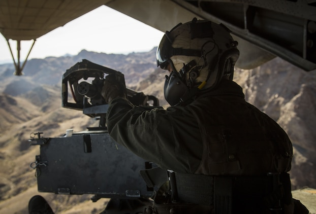 U.S. Marine Corps Cpl. Mitchell McCartney, a crew member assigned to Marine Heavy Helicopter Squadron (HMH) 465, operates the M2 Browning heavy machine gun at the rear of the CH-53E Super Stallion as it flies above the Chocolate Mountain Aerial Gunnery Range, Dec. 9, 2017. HMH-465 arrived to MCAS Yuma, Nov. 29, 2017 to conduct training in support of Exercise Winter Fury. Exercise Winter Fury allows Marines to exercise the skills needed as the combat element of the Marine Air Ground Task Force during a combat deployment. (U.S. Marine Corps photo by Cpl. Isaac D. Martinez)