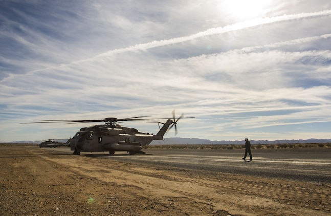 U.S. Marine Corps Cpl. Mitchell McCartney, a crew member assigned to Marine Heavy Helicopter Squadron (HMH) 465, walks toward a CH-53E Super Stallion as it sits on the flight line at Marine Corps Air Ground Combat Center Twenty-nine Palms, Calif., Dec. 9, 2017. HMH-465 arrived to MCAS Yuma, Nov. 29, 2017 to conduct training in support of Exercise Winter Fury. Exercise Winter Fury allows Marines to exercise the skills needed as the combat element of the Marine Air Ground Task Force during a combat deployment. (U.S. Marine Corps photo by Cpl. Isaac D. Martinez)