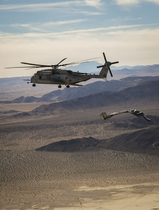 A CH-53E Super Stallion, assigned to Marine Heavy Helicopter Squadron (HMH) 465, conducts an airdrop above Marine Corps Air Ground Combat Center Twenty-nine Palms, Calif., Dec. 9, 2017. HMH-465 arrived to MCAS Yuma, Nov. 29, 2017 to conduct training in support of Exercise Winter Fury. Exercise Winter Fury allows Marines to exercise the skills needed as the combat element of the Marine Air Ground Task Force during a combat deployment. (U.S. Marine Corps photo by Cpl. Isaac D. Martinez)