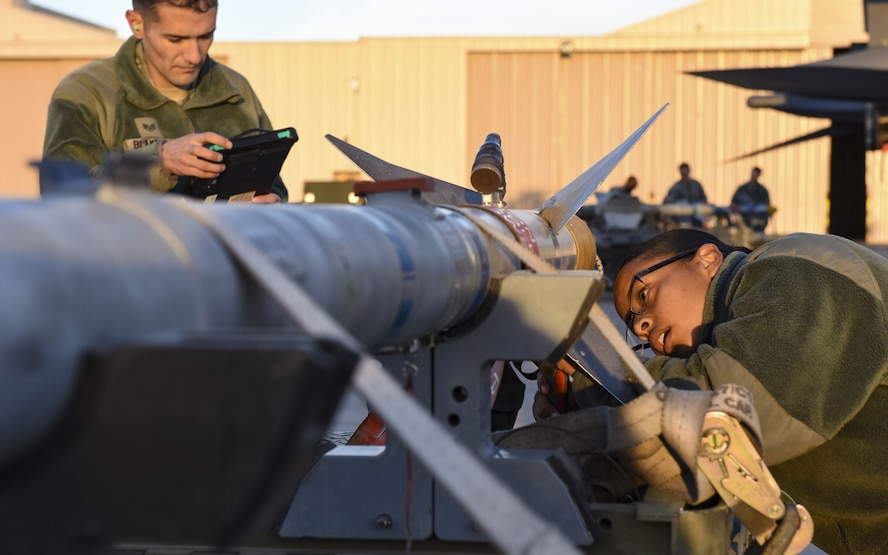 Airmen from the 57th Maintenance Group perform an inspection on an AIM-120 AMRAA during the quarterly load crew competition at Nellis Air Force Base, Nev., Jan. 5, 2018. The teams were evaluated on their speed and accuracy while loading munitions onto their aircraft. (U.S. Air Force photo by Airman 1st Class Andrew D. Sarver/Released)