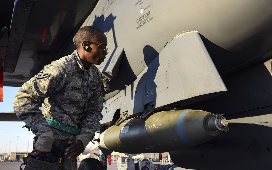 An Airman from the 57th Maintenance Group performs a final inspection on a Mark 84 bomb assembly during the quarterly load crew competition at Nellis Air Force Base, Nev., Jan. 5, 2018. A team's accuracy, speed and focus on safety determined whether it would finish first or last in the competition. (U.S. Air Force photo by Airman 1st Class Andrew D. Sarver/Released)