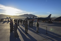 Airmen gather around an A-10 Thunderbolt II, F-22 Raptor and F-16 Fighting Falcon after the quarterly load crew competition at Nellis Air Force Base, Nev., Jan. 5, 2018. Multiple squadrons from the 57th Maintenance Group participated in the competition. (U.S. Air Force photo by Airman 1st Class Andrew D. Sarver/Released)