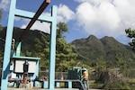 man works on generator