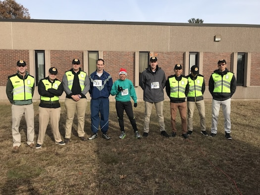 "Participants of the 2nd Annual ""Fill Our Rucks"" 5k run pose for a picture December 2, 2017 at Bradley Air National Guard Base, East Granby, Conn."