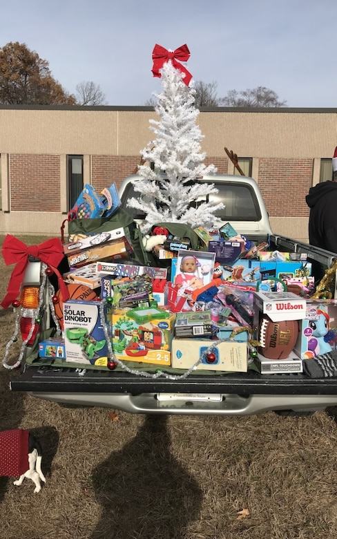 "A truck is filled with toys during the 2nd Annual ""Fill Our Rucks"" 5k run December 2, 2017."