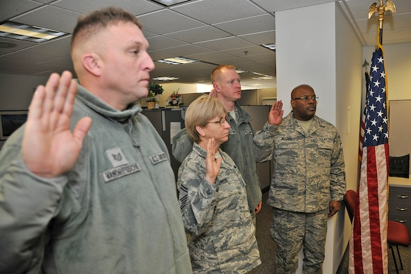 Members of the 127th Wing re-enlist in the Michigan Air National Guard at Selfridge Air National Guard Base, Mich., Jan. 6, 2018. Over the past year there were 280 enlistments and re-enlistments in the Michigan Air National Guard here.