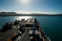 The amphibious assault ship USS America (LHA 6) pulls into Guam for a scheduled port visit. America, part of the America Amphibious Ready Group, with embarked 15th Marine Expeditionary Unit, is operating in the Indo-Asia-Pacific region to strengthen partnerships and serve as a ready-response force for any type of contingency.