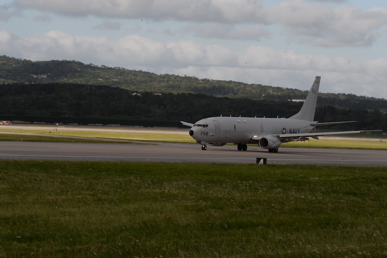 A P-8A Poseidon assigned to the Fighting Tigers of Patrol Squadron (VP) 8 takes off from a runway at Kadena Air Base, Japan. VP-8 is currently deployed to the 7th Fleet area of operations conducting missions and providing Maritime Domain Awareness to supported units throughout the Indo-Asia-Pacific region.