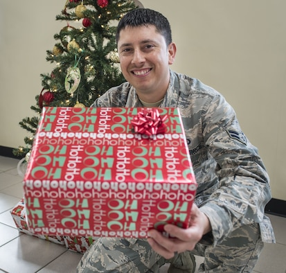 Airman 1st Class Guadalupe Salinas, 36th Operations Support Squadron weather forecaster, volunteered to be the liaison to ensure each child received a gift during the Merizo Angel Tree event, held Dec. 23, 2017, at Merizo Village, Guam. Airmen with the 36th OSS at Andersen Air Force Base, along with the U.S. Coast Guard Auxiliary, Station Apra Harbor, the Merizo Mayor's office and volunteers came together for the Merizo Angel Tree event to spread joy to community members. (U.S. Air Force photo by Airman 1st Class Christopher Quail)