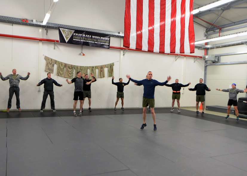 Airmen from multiple units participate in a warm-up at the 435th Security Forces Squadron gym on Ramstein Air Base, Germany, Jan. 5, 2018. Explosive Ordinance Disposal Airmen, Security Forces, and the 435th Air Ground Operations Wing leadership, came together to remember and honor fallen EOD service members. (U.S. Air Force photo by Senior Airman Jimmie D. Pike)