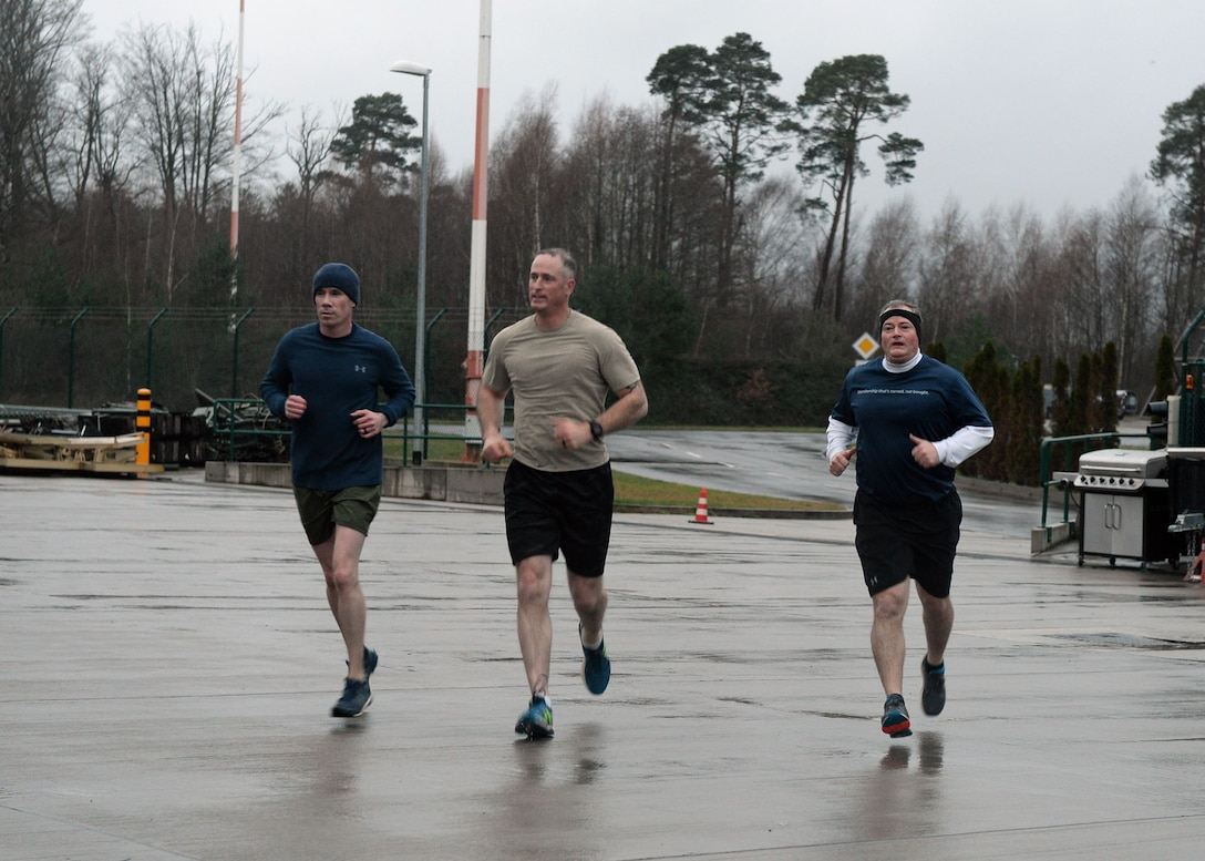 From left to right, Maj. John Sullivan, 435th Security Forces Squadron commander, Chief Master Sgt. Heath Tempel, 435th Air Ground Operations Wing and 435th Air Expeditionary Wing command chief, and Col. Matthew Villella, 435th AGOW/AEW vice commander, run during an Explosive Ordinance Disposal Fallen Warrior Workout on Ramstein Air Base, Germany, Jan 5, 2018. Explosive Ordinance Disposal Airmen, Security Forces, and the 435th Air Ground Operations Wing leadership, came together to remember and honor fallen EOD service members. (U.S. Air Force photo by Senior Airman Jimmie D. Pike)