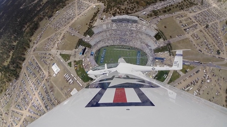 Lt. Col. Noel Williams glides over the U.S. Air Force Academy football stadium during his December fini flight. Recently promoted to colonel, Williams will serve as a special assistant to the 340th Flying Training Group commander. (U.S. Air Force photo)