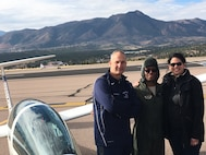 Lt. Col. Noel Williams (center) shares a moment following his final glider flight with wife Michelle and teammate Mark Matticola, U.S. Air Force Academy instructor pilot. Recently promoted to colonel, Williams will serve as a special assistant to the 340th Flying Training Group commander. (U.S. Air Force photo)