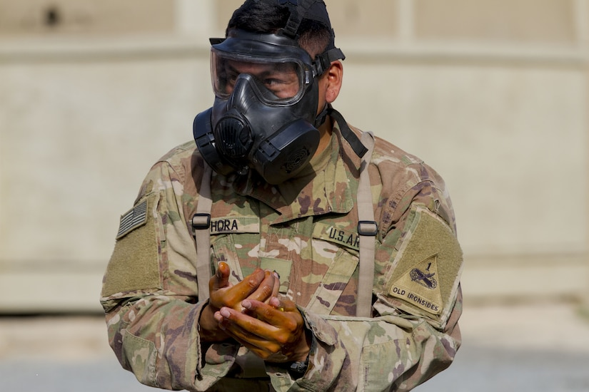 Soldier with a gas mask on.