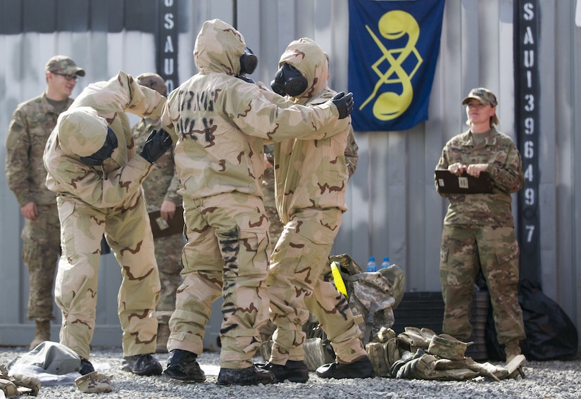 Group of Soldiers in decontamination gear.