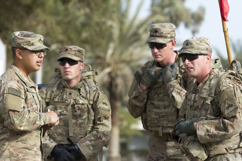 Four Soldiers standing in a group.