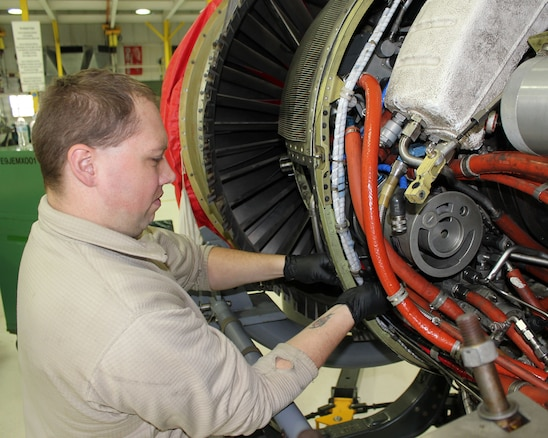Airman 1st Class Johnny Bowen works on a TF34 jet engine from an A-10 Thunderbolt II at Selfridge Air National Guard Base, Mich., Jan 6, 2018. Bowen is an aerospace propulsion technician for the 127th Aircraft Maintenance Squadron.