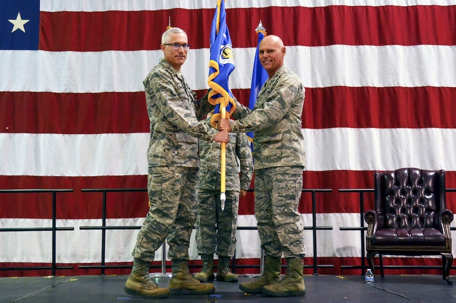 Brig. Gen. Richard Kemble receives the 94th Airlift Wing guidon from Maj. Gen. Craig L. La Fave, 22nd Air Force commander, during an assumption-of-command ceremony at Dobbins Air Reserve Base, Ga., Jan. 6, 2018. (U.S. Air Force photo by Tech. Sgt. Kelly Goonan)