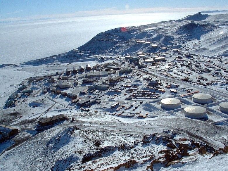 The National Science Foundation's McMurdo Station, as seen from the summit of Observation Hill, Antarctica. The station was established in December 1955 and is the logistics hub of the U.S. Antarctic Program, with a harbor, landing strips on sea ice and shelf ice, and a helicopter pad. (Courtesy Photo)