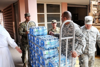 Puerto Rico Army National Guardsmen assigned to the 92nd Maneuver Enhancement Brigade distribute needed articles, food and water after Hurricane Maria in San Juan, Puerto Rico, Dec. 29, 2017. Puerto Rico Army National photos by Spc. Hamiel Irizarry