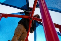 Bart Cason, professional playground installer, assembles a canopy, Jan. 4, 2018, at Moody Air Force Base, Ga. The 23d Force Support Squadron rebuilt and designed the new playground to improve quality of life and safety for Team Moody families. (U.S. Air Force photo by Airman 1st Class Erick Requadt)