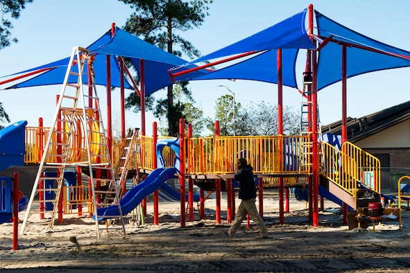 Professional playground installers construct a new playground, Jan. 4, 2018, at Moody Air Force Base, Ga. The 23d Force Support Squadron rebuilt and designed the new playground to improve quality of life and safety for Team Moody families. (U.S. Air Force photo by Airman 1st Class Erick Requadt)