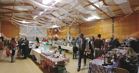 Holiday Markets bring dozens of local vendors like handmade clothing, decorative wood frames and facial remedies to wrap as holiday gifts or stocking stuffers at Lazy-T Ranch, Manhattan Dec. 9.
