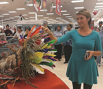 A patron of the Fort Riley Main Exchange pulls a feather off a turkey during Black Friday event Nov. 24. Each feather pulled reveal mystery deal to be used at the Exchange. This year, the PX experienced a 3 percent rise in sales on Black Friday and a 10 percent rise in sales during Thanksgiving weekend.