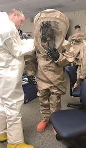 Fort Riley Soldiers suit up during the Hazardous Waste Worker training course mitigation lessons at a hazardous site Dec. 8. Barton Community College offers free training to Soldiers interested in receiving five college credits, two certificates and an Occupational Safety and Health Administration card.
