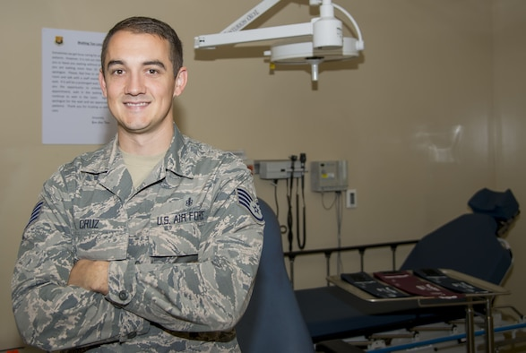 Staff Sgt. Brandon Cruz, an aerospace medical technician assigned to the 6th Medical Operations Squadron, pauses for a photo in the 6th Medical Group Clinic at MacDill Air Force Base, Fla., Dec. 21, 2017. Cruz provided lifesaving medical care to a young boy at the scene of an accident, Nov. 22, 2017. (U.S. Air Force photo by Senior Airman Mariette Adams)