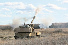 A new M109A7 Paladin howitzer fires an artillery round from a Fort Riley range during a test session of field equipment by Soldiers from Battery D, 1st Battalion, 5th Field Artillery Regiment, 1st Armored Brigade Combat Team, 1st Infantry Division Dec. 6.