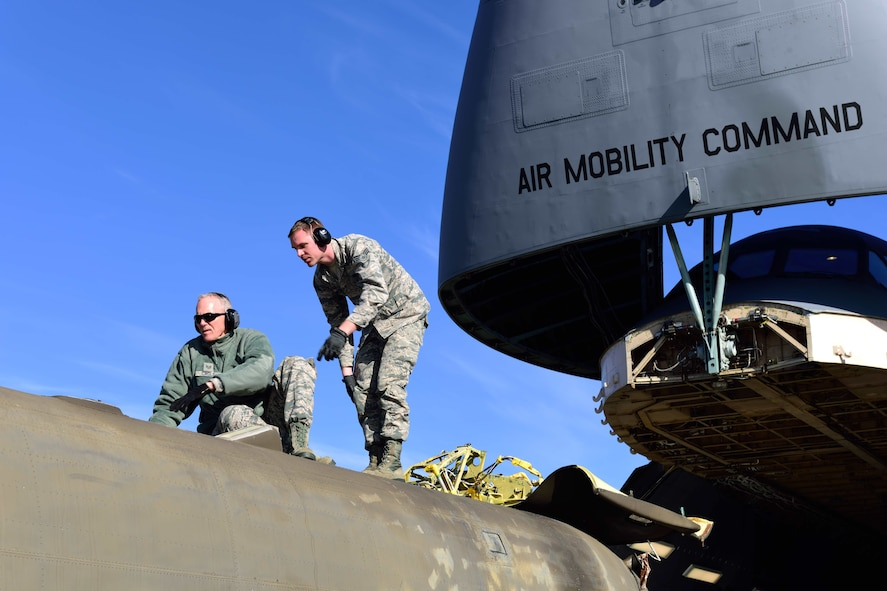 Staff Sgt. Jim Cagle and Senior Airman Preston Spear, 41st Aerial Port Squadron air transportation technicians out of Keesler Air Force Base, Miss., check the clearance of a CH-47 Chinook helicopter to make sure it will fit into cargo bay of the C-5M Super Galaxy aircraft at the Gulfport Combat Readiness Training Center – Battlefield Airman Center, Miss., Jan. 6, 2018.  Reservists, guardsmen, civilians and active-duty members from the Air Force, Army and Navy worked side by side during this training event called Breaking Barriers GRIP III Jan. 5-7, highlighting the joint effort of this training opportunity. (U.S. Air Force photo by Tech. Sgt. Ryan Labadens)