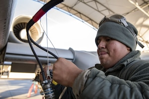 Senior Airman Carlos Ramon-Cruz, 75th Aircraft Maintenance Unit crew chief, connects a radio wire, Jan. 5, 2018, at Moody Air Force Base, Ga. Team Moody resumed its flying operations after a Jan. 3 snow storm halted all maintenance and flying operations. (U.S. Air Force photo by Airman Eugene Oliver)