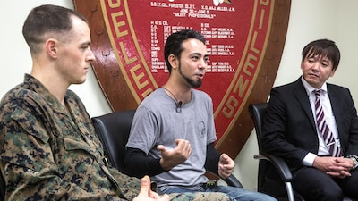 1st Lt. Aaron Cranford speaks in an interview with Justin Kinjo and Yusuke Teruya, divers who almost lost their lives at the hands of a rip current, after the he receives the Navy and Marine Corps Medal on Jan. 8, 2017, at the 3rd Reconnaissance Battalion Headquarters building on Camp Schwab, Okinawa, Japan. Cranford was awarded the Navy and Marine Corps Medal for risking his life while rescuing three divers and a local Okinawan who were caught in rip current during a recreational dive at Onna Point, Okinawa, Japan on April 23, 2017. Cranford, a native of Fort Worth, Texas, is a supply officer with Headquarters and Service Company, 3rd Reconnaissance Battalion, 3rd Marine Division.