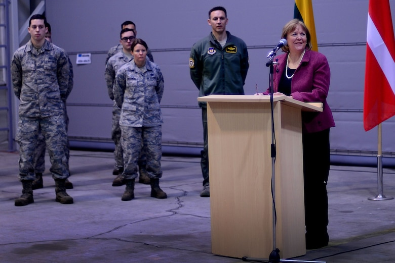 U.S. Ambassador Anne Hall congratulates U.S. Airmen from the 493rd Expeditionary Squadron on a successful NATO Baltic Air Police rotation during the official Handover, Takeover ceremony at Siauliai Air Base, Lithuania, Jan. 8. The U.S. Air Force transferred control of BAP operations to the Royal Danish air force to protect the sovereign skies above the Baltic region. (U.S. Air Force photo/ Tech. Sgt. Matthew Plew)
