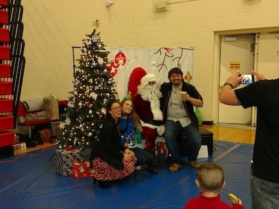 Celebrating with Santa at the Holiday party. December 8, 2017