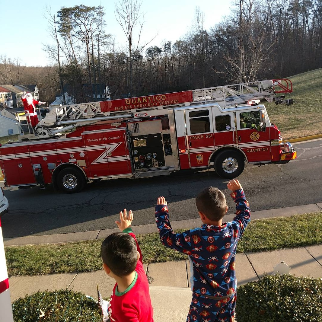 Community Support during the holidays is what makes this Base great. Firefighters from Security Battalion doing Santa visits to all the Base Neighborhoods.