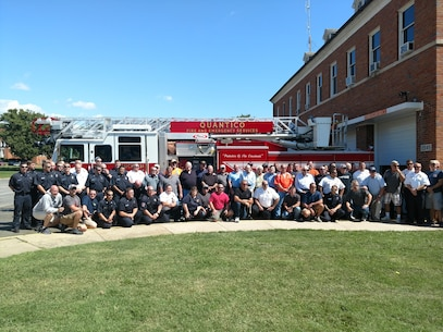 Posing are past and present Firefighters of Marine Corps Base Quantico as they celebrate there 100 years of support to MCB Quantico. September 8, 2017.