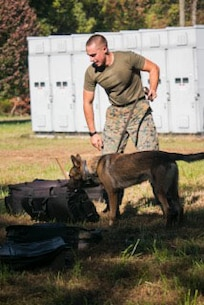 Marines from Security Battalion Participating in the Iron Dog Competition, shown here is a Marine and his dog doing the search detection event of the competition. October 20, 2017.