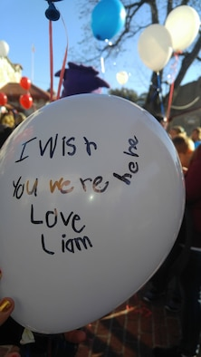Balloons with messages written for deceased military members by their children were released at Snowball Express in Dallas, Dec. 9, 2017. Balloon send-offs offer children a chance to share a special message with those they have lost. (Courtesy photo)