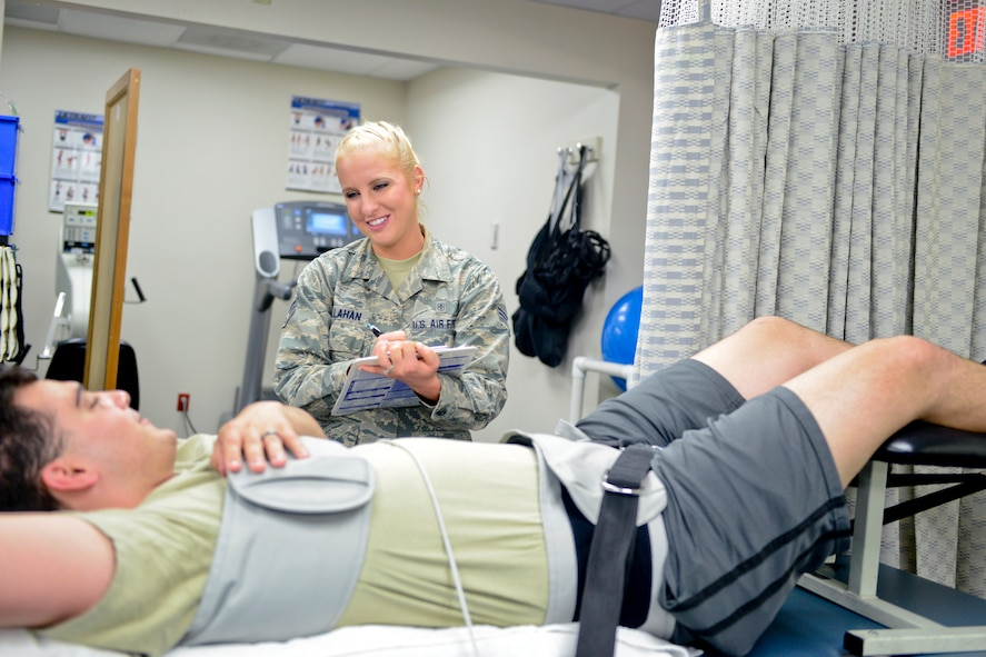 Senior Airman Kaitlyn Callahan, 341st Medical Operations Squadron physical therapy technician, assists an Airman Aug. 12, 2017, at Malmstrom Air Force Base, Mont.