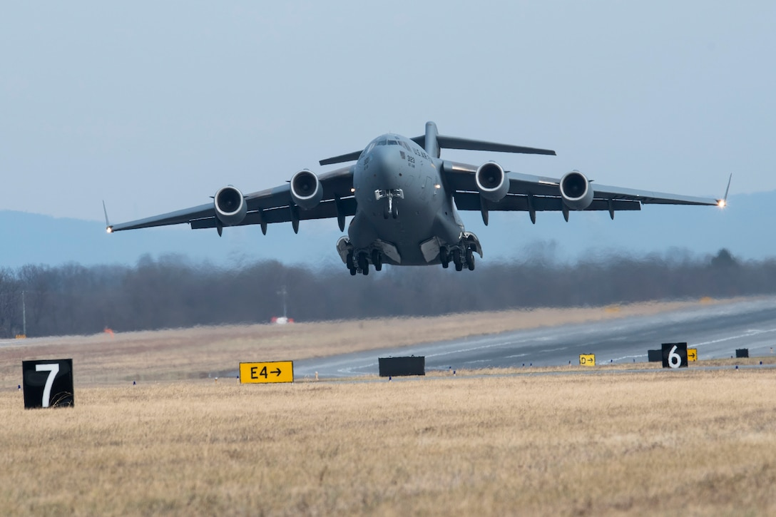 A C-17 Globemaster III aircraft takes off for a training flight from Shepherd Field, Martinsburg, W.Va., Dec 20. Aircrews fly routine training missions in addition to numerous Guard and Tanker Airlift Control Center missions each month. (U.S. Air National Guard photo by Senior Master Sgt. Emily Beightol-Deyerle)