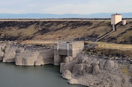 """Geotechnical Engineer Ken Pattermann and Philip """"Junior"""" Golia walk along the top of the 2,970-foot Black Butte Dam as part of an annual inspection by U.S. Army Corps of Engineers Sacramento District."""