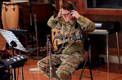 Army Spc. Trenton Frizzell from the Army Materiel Command Band gears up for the recording session at Fame Studios in Muscle Shoals, Ala.