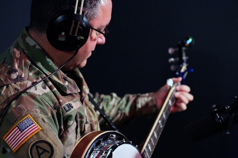 Army Sgt. 1st Class Thomas Lindsey from the Army Field Band's Six-String Soldiers prepares for a recording session at Fame Studios in Muscle Shoals, Ala.
