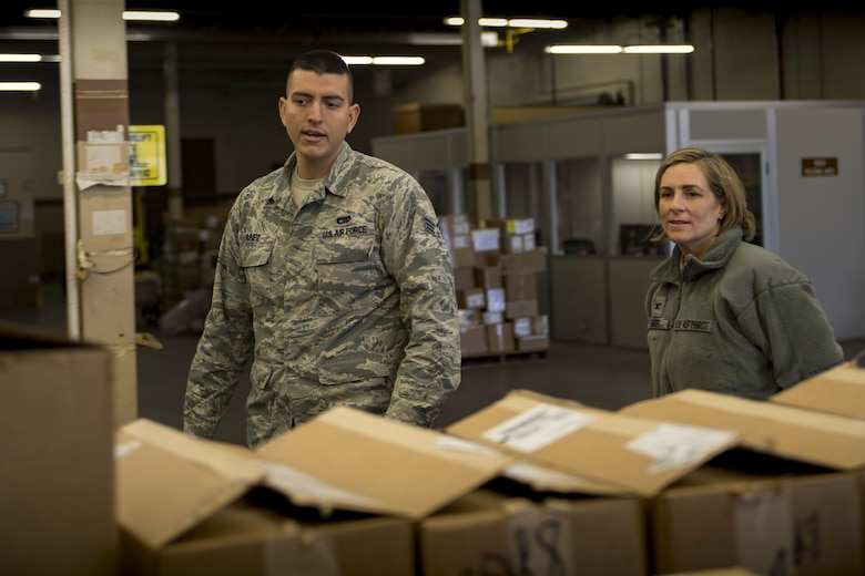Senior Airman Michael Nunez, 23d Logistics Readiness Squadron transit management inbound specialist, demonstrates his day-to-day duties to Col. Jennifer Short, 23d Wing commander, Jan. 8, 2018, at Moody Air Force Base, Ga. Short's immersion allowed her to see the processes aircraft parts go through from the time they arrive at Moody to when they're placed on the aircraft. (U.S. Air Force photo by Senior Airman Daniel Snider)
