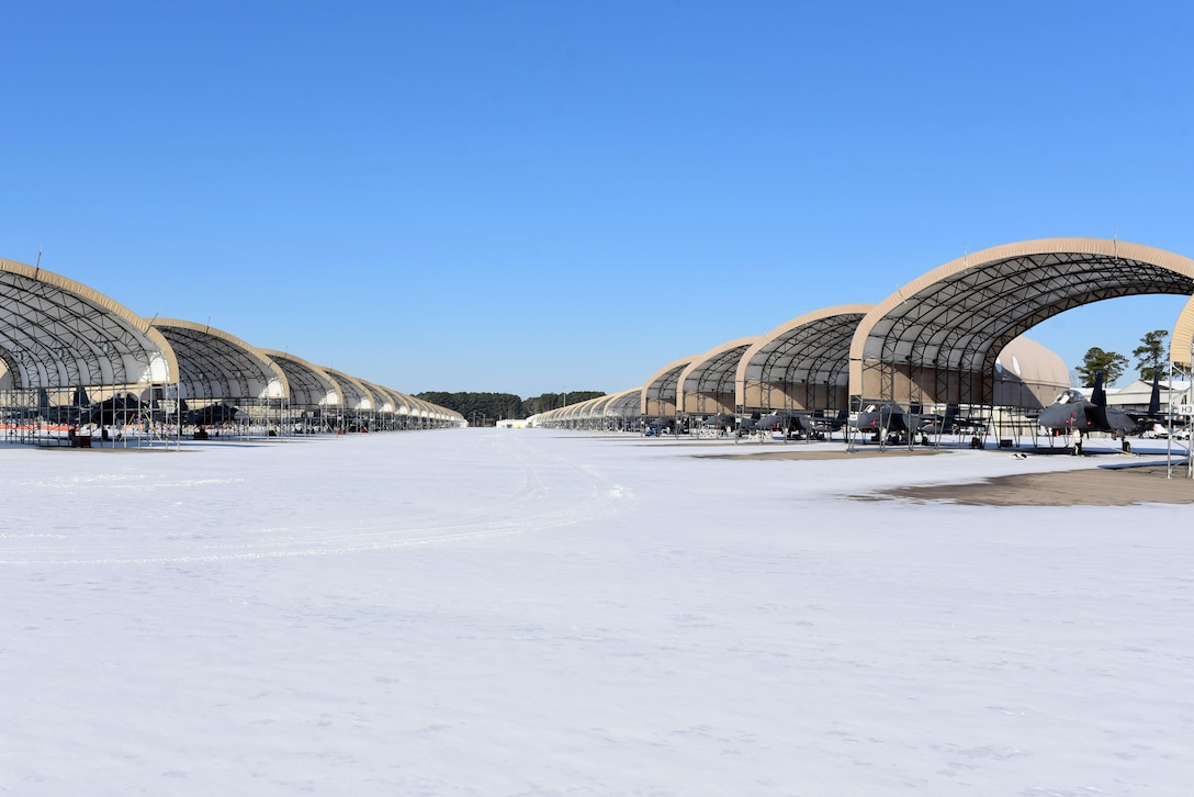 Several F-15E Strike Eagles on a snow covered flight line Jan. 4, 2018, at Seymour Johnson Air Force Base, North Carolina. Seymour Johnson AFB was hit with a snow storm Jan. 3 that dropped several inches of snow over a 12-hour period. (U.S. Air Force photo by Airman 1st Class Victoria Boyton)