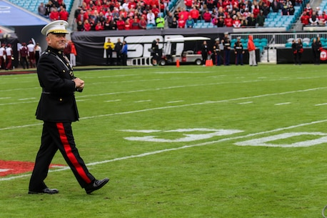 Brigadier General Austin E. Renforth, commanding general of Marine Corps Recruit Depot Parris Island and the Eastern Recruiting Region, walks onto EverBank Field for the coin-toss before the start of the  TaxSlayer Bowl, Dec. 30, 2017, in Jacksonville, Florida. Renforth was invited by the Jacksonville Sports Council to be the guest-of-honor during the game. (U.S. Marine Corps Photo by Sgt. Tony Simmons)