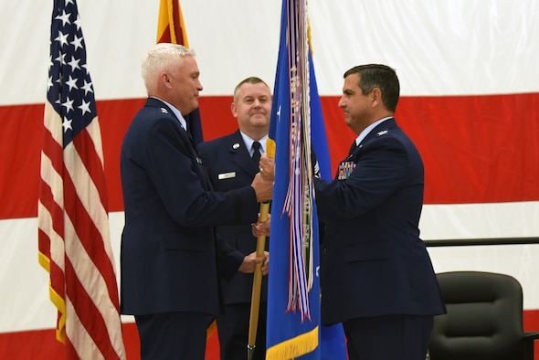 Col. Patrick W. Donaldson accepts the 161st Air Refueling Wing guidon from Maj. Gen. Edward Maxwell, Arizona Air National Guard Air Component Commander,  during the change of command ceremony at Goldwater Air National Guard Base, Jan. 7, 2017.